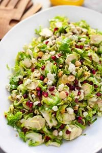 shaved brussels sprout salad on white platter