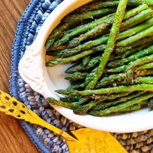 roasted green asparagus on white platter
